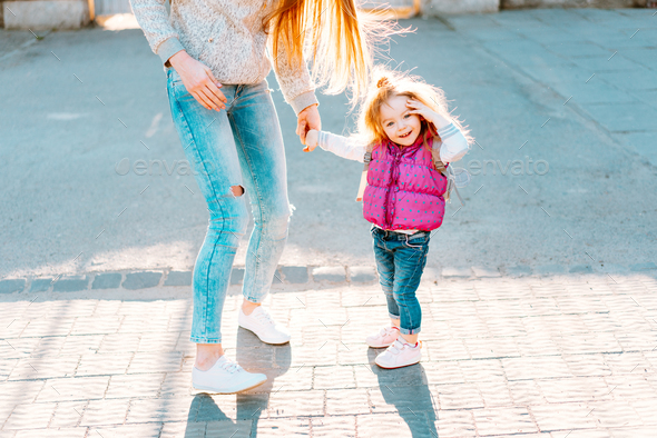 Mom and girl playing, having fun - Stock Photo - Images