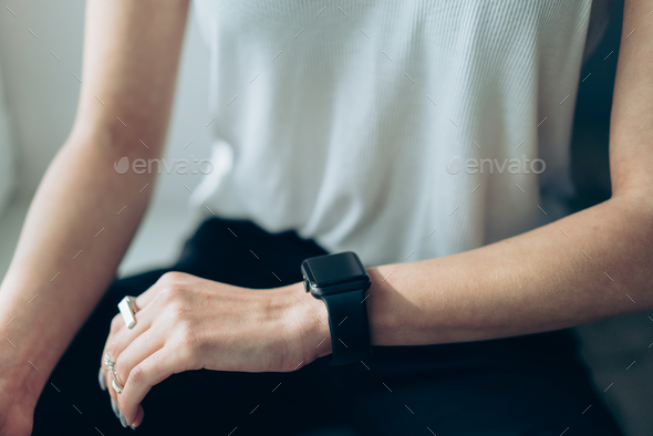 Slender girl with a smart clock on her arm - Stock Photo - Images