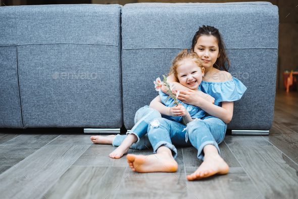 Elder and younger daughter on the floor - Stock Photo - Images