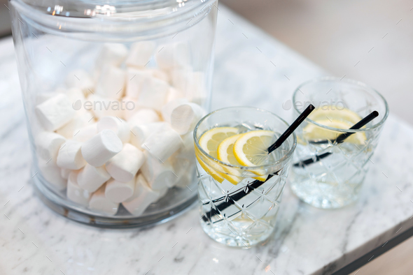 Lemon water and sweets. - Stock Photo - Images