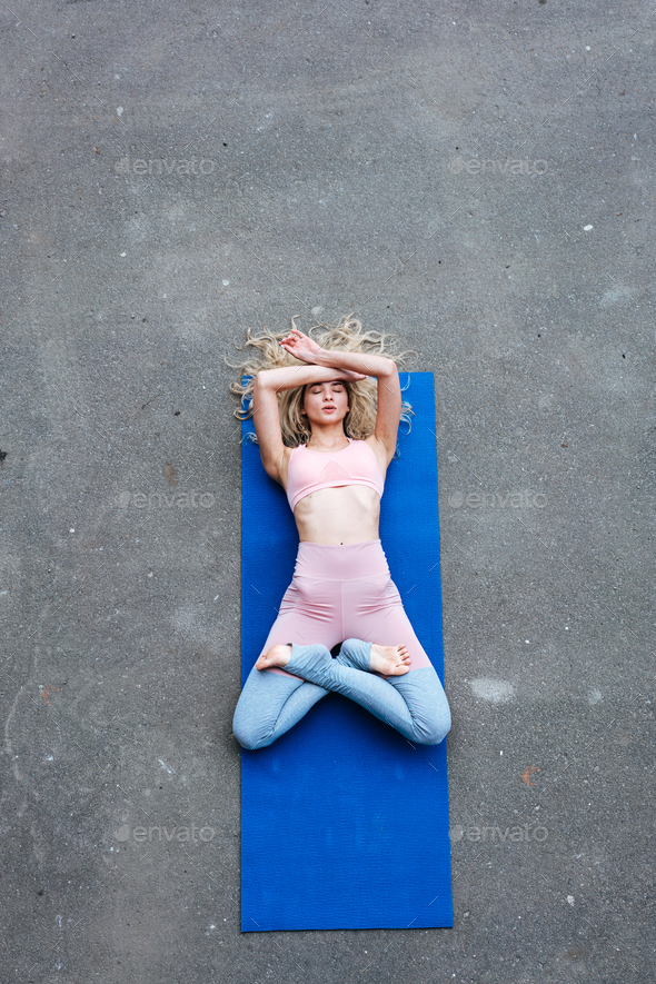 Young slim blond woman making yoga exercises - Stock Photo - Images
