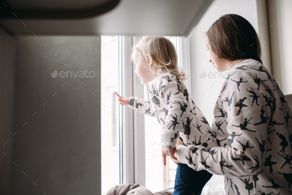 Mother and her daughter girl play in kids room - Stock Photo - Images