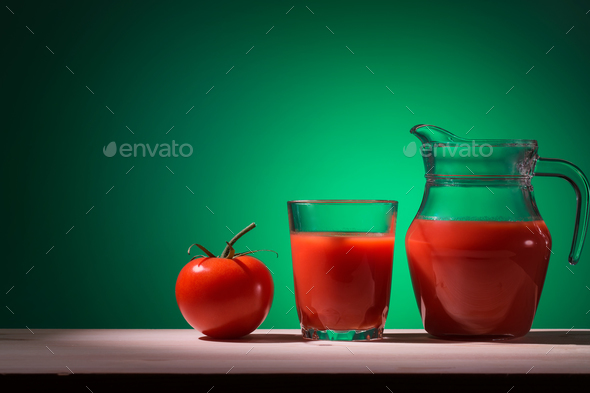 Tomato glass and jug with tomato juice - Stock Photo - Images