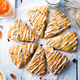 Scones with oats, cranberry and pecan nuts on wooden background. Top view. - PhotoDune Item for Sale