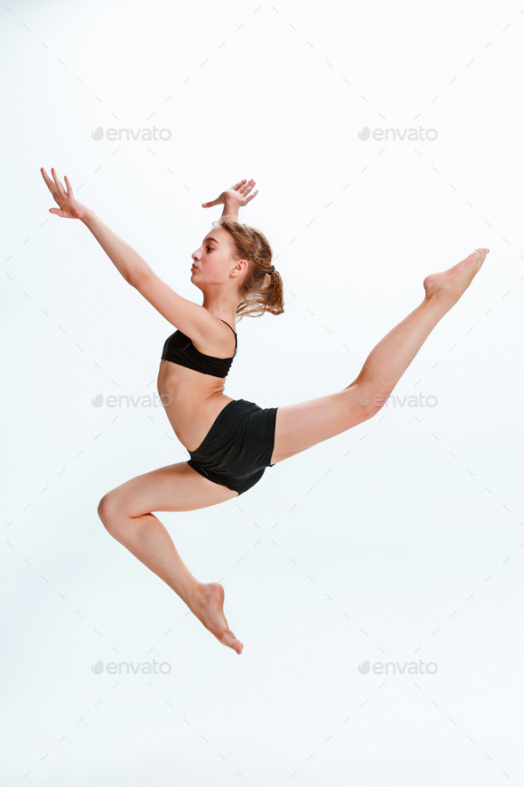 The girl jumping as modern ballet dancer - Stock Photo - Images