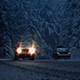 Cars Drive Through Snowstorm In The Evening - VideoHive Item for Sale