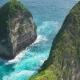 Waves in Ocean Around the Rocks Formation on Kelingking Beach, Nusa Penida Island, Bali, Indonesia