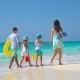Family of Four on a Tropical Beach - VideoHive Item for Sale