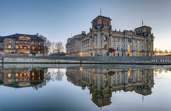 The Reichstag at the river Spree in Berlin - Stock Photo - Images