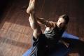 Handsome strong sportsman in gym make yoga sport exercises