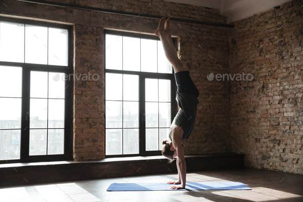 Attractive strong sportsman in gym make yoga sport exercises - Stock Photo - Images