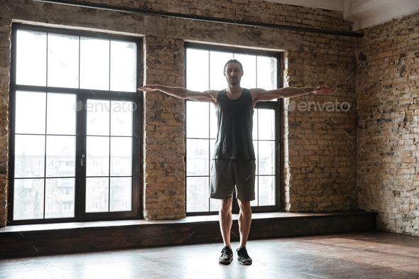 Young confident sportsman warming up at the gym - Stock Photo - Images