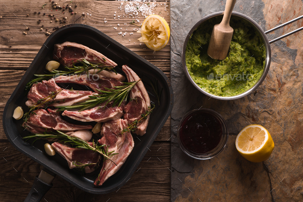 Ribs of lamb in saucepan and mashed potatoes and peas in a ladle - Stock Photo - Images