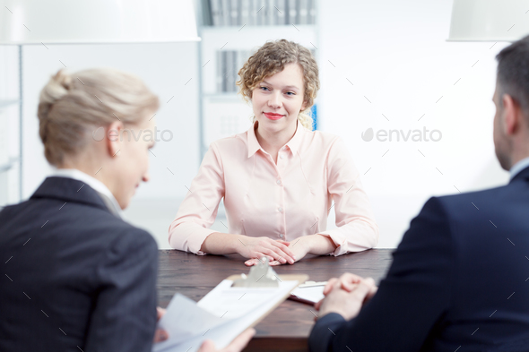 Woman smiling during recruitment review - Stock Photo - Images