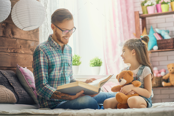 daddy reading a book - Stock Photo - Images