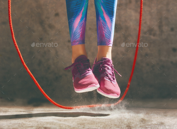Woman with skipping rope. - Stock Photo - Images