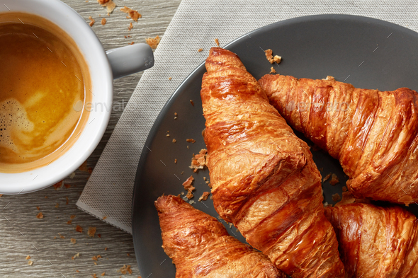 freshly baked croissants and coffee espresso - Stock Photo - Images