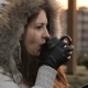 Girl Drinking Hot Tea or Coffee From a Cup on a Winter Morning Outside - VideoHive Item for Sale