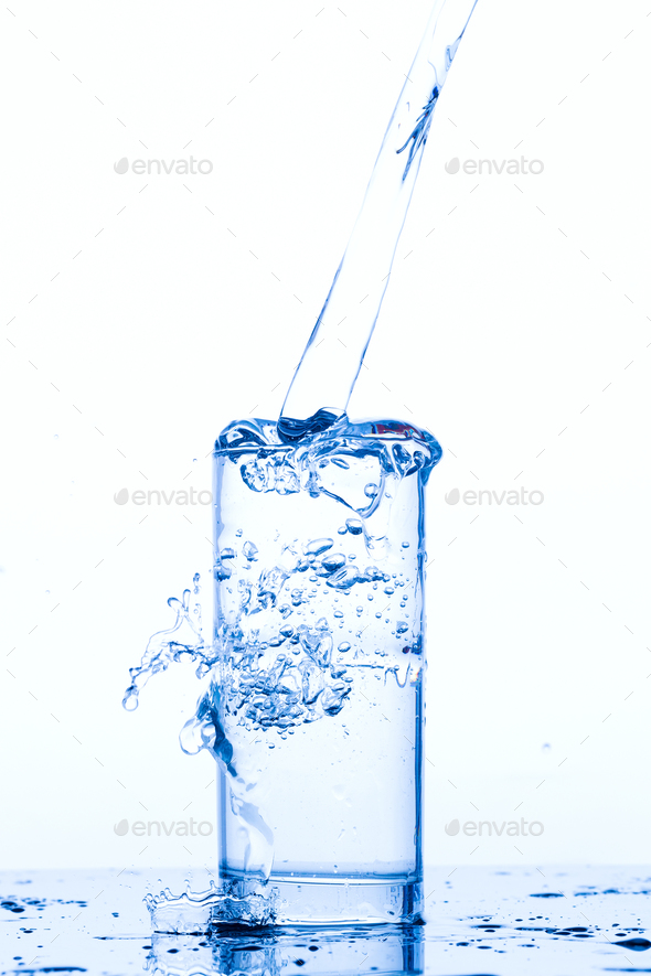 Glass with pouring drinking water - Stock Photo - Images