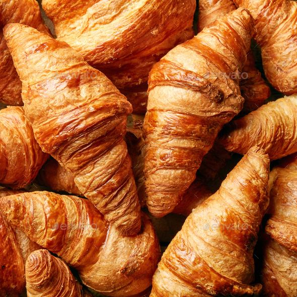 freshly baked croissant background - Stock Photo - Images