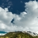 Clouds Drifting Along Top of Rocky Mountain Peaks - VideoHive Item for Sale