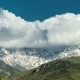 Intense Clouds Roiling and Flowing Over Peaks of the Mountain in Alaska - VideoHive Item for Sale