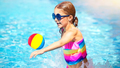 Little girl playing in the pool - PhotoDune Item for Sale