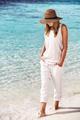 Nice girl walking on the beach - PhotoDune Item for Sale