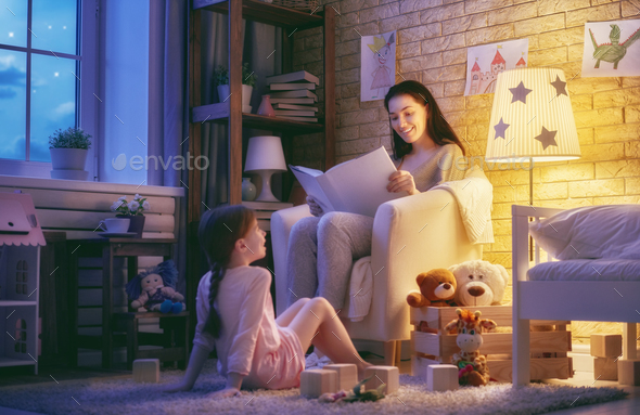 Family reading bedtime. - Stock Photo - Images