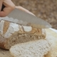Men's Hands Cut a Loaf of Bread - VideoHive Item for Sale