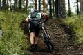 Male Cyclist Climbs Uphill