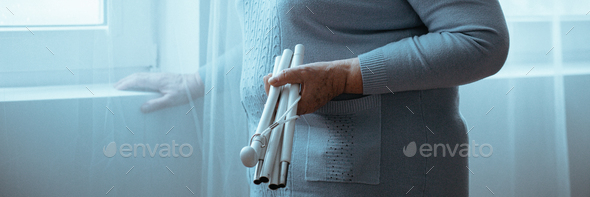 Woman with Parkinson's holding stick - Stock Photo - Images