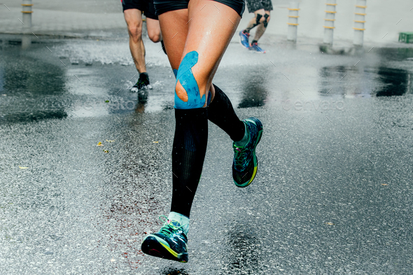 Feet Girl Runners in Compression Sock - Stock Photo - Images