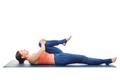 Woman doing Hatha Yoga asana Ardha pawanmuktasan