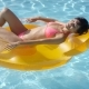 Relaxed Young Woman Sunbathing in a Pool - VideoHive Item for Sale