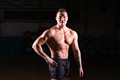 Strong Athletic Man Fitness Model Torso showing six pack abs in gym