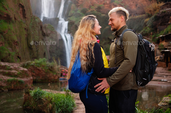Adventurer couple near Ouzoud waterfall in Morocco - Stock Photo - Images