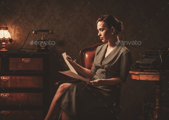 Beautiful woman reading in retro interior - Stock Photo - Images