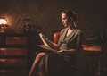 Beautiful woman reading in retro interior - PhotoDune Item for Sale