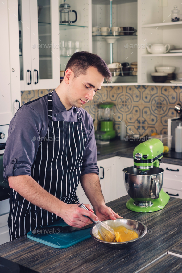 Chef cook working on a modern kitchen at home - Stock Photo - Images