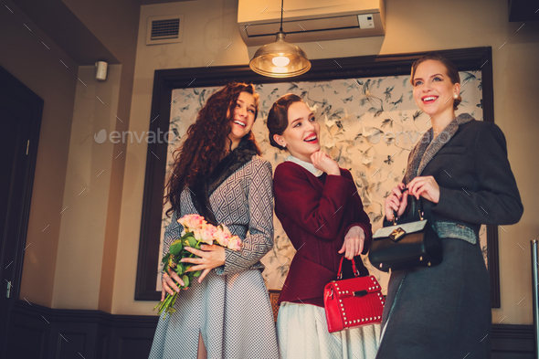 Three elegant young ladies ready for a party - Stock Photo - Images