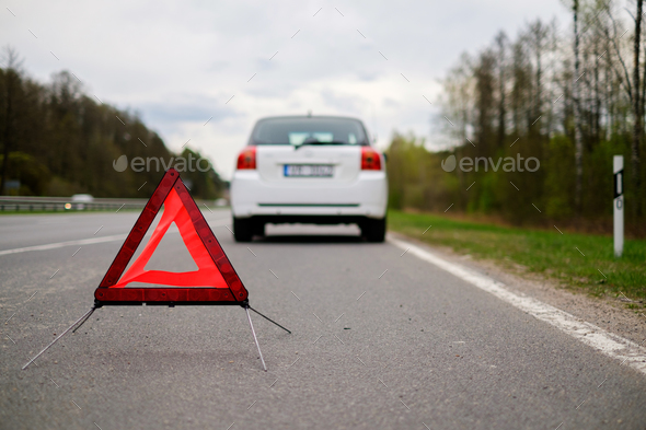 Broken car on a road side - Stock Photo - Images