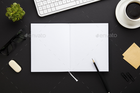 Blank Paper Surrounded By Office Supplies On Gray Desk - Stock Photo - Images