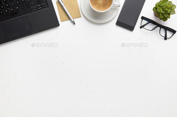 Laptop With Coffee Cup, Eyeglasses And Smartphone On White Desk - Stock Photo - Images