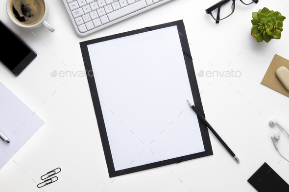 Folder Surrounded With Office Supplies - Stock Photo - Images