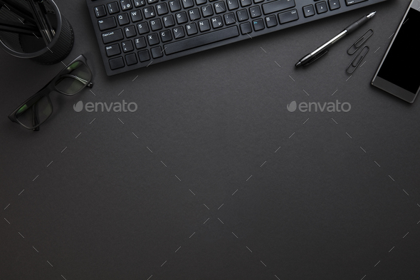 Computer Keyboard With Eyeglasses And Office Supply On Gray Desk - Stock Photo - Images