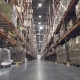 Interior of Warehouse with Racks Full of Cardboxes
