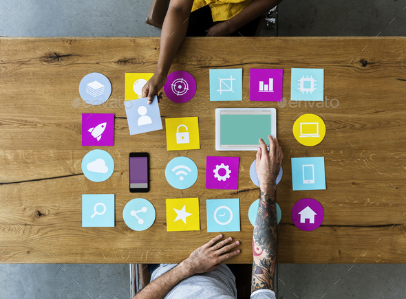 Group of computer icon on the wooden table - Stock Photo - Images