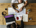 Colleagues Working on Web Design Startup Together on Wooden Tabl - PhotoDune Item for Sale