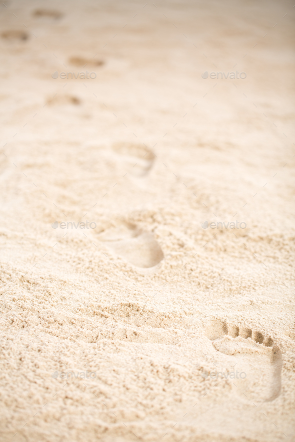 Footprints on sand - Stock Photo - Images